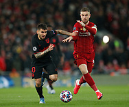 Angel Correa of Atletico Madrid tussles with Jordan Henderson of Liverpool during the UEFA Champions League match at Anfield, Liverpool. Picture date: 11th March 2020. Picture credit should read: Darren Staples/Sportimage