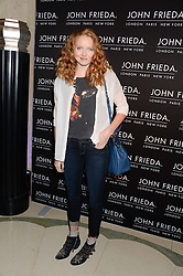 LILY COLE at a party to celebrate 25 years of John Frieda held at Claridge's, Brook Street, London on 29th October 2013.