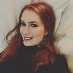 """Felicia Day releases a photo on Twitter with the following caption: """"""""Made the mistake of laying down on the couch before going out to a party. 50/50 I get up again."""""""". Photo Credit: Twitter *** No USA Distribution *** For Editorial Use Only *** Not to be Published in Books or Photo Books ***  Please note: Fees charged by the agency are for the agency's services only, and do not, nor are they intended to, convey to the user any ownership of Copyright or License in the material. The agency does not claim any ownership including but not limited to Copyright or License in the attached material. By publishing this material you expressly agree to indemnify and to hold the agency and its directors, shareholders and employees harmless from any loss, claims, damages, demands, expenses (including legal fees), or any causes of action or allegation against the agency arising out of or connected in any way with publication of the material."""