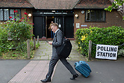A businessman son the morning of the UK 2017 general elections strides past the polling station at St. Barnabas Parish Hall in Dulwich Village  on 8th June 2017, in London, England.
