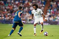 Real Madrid's player Marcelo and Celta de Vigo's player Nemanja Radoja during a match of La Liga Santander at Santiago Bernabeu Stadium in Madrid. August 27, Spain. 2016. (ALTERPHOTOS/BorjaB.Hojas)