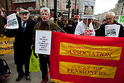 Members of the Greater London Pensioners Association join in the protest in support. Disabled and able bodied demonstrators chain themselves together and block Oxford Circus in central London. Protesting at the Tory parties Welfare Reform Bill (WRB) which the government plans to make law by May 2012 could leave thousands destitute. It will affect disabled people badly with a cap on benefits and cutting additional support despite promises not to do so.