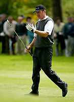 Photograph: Scott Heavey<br />Volvo PGA Championship At Wentworth Club. 23/05/2003.<br />Nick faldo checks the grip of his glove after slicing on the 7th.
