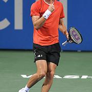 STEFANOS TSITSIPAS pumps his fist at the Rock Creek Tennis Center.