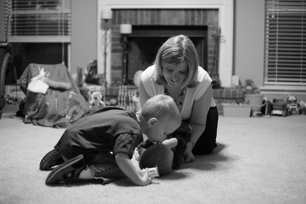 """Kade's older brother Jackson, 3, gives him a kiss before leaving for preschool as mother Annette changes his diaper. """"I don't think Jackson realizes how different things are,"""" says father Josh Bauman. """"Kade's just his brother and he loves him."""""""