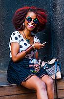 Trendy young woman in the hip urban neighborhood of Maboneng Precinct, Johannesburg, South Africa.