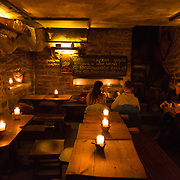 People inside legendary medieval Third Dragon Pub and Cafe, Tallinn, Estonia