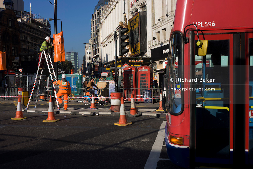 Roadworks connected to the Crossrail construction project at Tottenham Court Road, central London.