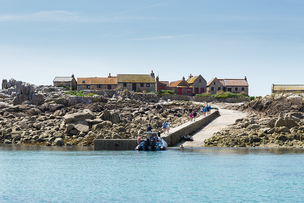 Tourists arriving on a rib trip at the Minquiers, ready to explore the houses and views on the island