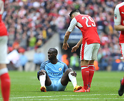 23 April 2017 FA Cup semi-final : Arsenal v Manchester City :<br /> Yaya Toure of City is offered a hand by Granit Xhaka.<br /> Photo: Mark Leech