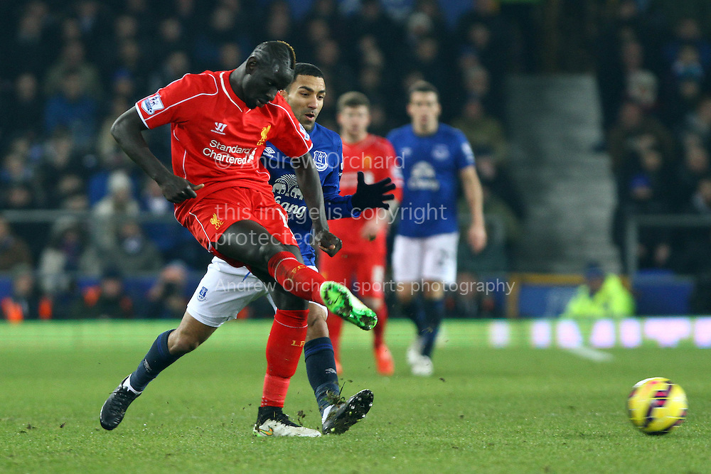 Mamadou Sakho of Liverpool passes the ball under pressure from Aaron Lennon of Everton. Barclays Premier league match, Everton v Liverpool at Goodison Park in Liverpool, Merseyside on Saturday 7th February 2015<br /> pic by Chris Stading, Andrew Orchard sports photography.