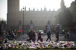 © Licensed to London News Pictures . 28/03/2017 . London , UK . Flowers and tributes in Parliament Square opposite Parliament in Westminster , in response to Khalid Masood's terrorist attack and the killing of PC Keith Palmer . Photo credit: Joel Goodman/LNP