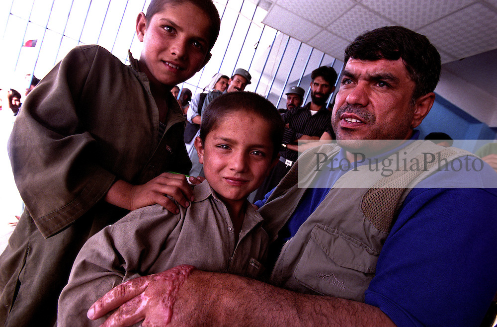 The President of Paralympic Federation Mr Abdul Rahman with children of Afghan at Ghazi Stadium.....On 23-25 August 2005, Special Olympics Afghanistan held its first national Games at Olympic Stadium in Kabul. ..More than 300 athletes, including 80 female athletes, experienced a taste of happiness and achievement for the first time in their lives. They competed in athletics, bocce and football (soccer). Because of cultural restrictions, males and