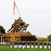 The Marine Corps Silent Drill Platoon performing at the Marine Corps Sunset Parade at the Marine Corps War Memorial (Iwo Jima Memorial) next to Arlington National Cemetery