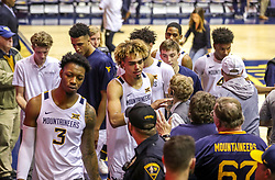 Dec 1, 2019; Morgantown, WV, USA; West Virginia Mountaineers forward Emmitt Matthews Jr. (11) and other players celebrate with fans after beating the Rhode Island Rams at WVU Coliseum. Mandatory Credit: Ben Queen-USA TODAY Sports