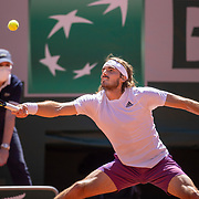 PARIS, FRANCE June 13.   Stefanos Tsitsipas of Greece in action against Novak Djokovic of Serbia on Court Philippe-Chatrier during the final of the singles competition at the 2021 French Open Tennis Tournament at Roland Garros on June 13th 2021 in Paris, France. (Photo by Tim Clayton/Corbis via Getty Images)