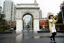 A woman pass by the Chinese activist and artist, Ai Weiwei's art project at Washington Square in New York,NY on October 12, 2017.   The artist assembeled 300 establishment around New York City statement  'Good Fences Make Good Neighbors'.  The works can be viewed through February 11, 2018. (Amir Levy/ SIPA USA)
