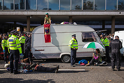 © Licensed to London News Pictures. 15/10/2019. London, UK. Extinction Rebellion protesters block the road on Millbank with a caravan. Police have said that any Extinction Rebellion protesters who continue will be liable for arrest. Photo credit: Rob Pinney/LNP