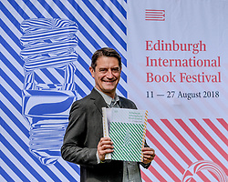 Pictured: Nick Barley Festival Director with the programme.<br /> <br /> The programme for the 2018 Edinburgh International Book Festival was launched in Edinburgh today (Thursday).<br /> <br /> © Dave Johnston / EEm