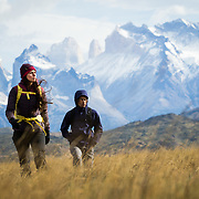 Attractive young couple hiking on an expedition with big mountains in the background.