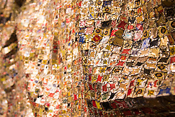 Bonhams, Mayfair, London. A detail of Peju's Robe, estimated at £450,000 - 550,000, by Ghanaian sculptor El Anatsui is made from thousands of pressed bottle tops to be auctioned at Bonhams post-war and Contemporary art sale. ///FOR LICENCING CONTACT: paul@pauldaveycreative.co.uk TEL:+44 (0) 7966 016 296 or +44 (0) 20 8969 6875. ©2015 Paul R Davey. All rights reserved.