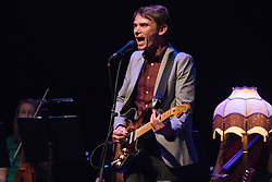 David Brewis of Field Music with the Open Here Orchestra performing live on stage at The Barbican in London. Photo date: Friday, May 25, 2018. Photo credit should read: Richard Gray/EMPICS
