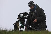 Photographer with marmot (model release 02/08/HTNP) Hohe Tauern National Park, Carinthia, Austria