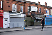 Local response to Coronavirus is felt on a street by street level as shops and small businesses are closed up with their shutters pulled down on 6th April 2020 in Birmingham, England, United Kingdom. Coronavirus or Covid-19 is a new respiratory illness that has not previously been seen in humans. While much or Europe has been placed into lockdown, the UK government has announced more stringent rules as part of their long term strategy, and in particular social distancing.