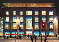 Night view of Harvey Nichols store with Christmas decorations in St Andrew Square, Edinburgh, Scotland, UK