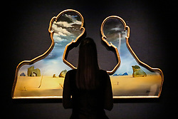 © Licensed to London News Pictures. 29/01/2020. London, UK. A staff member views Salvador Dalí, Couple aux têtes de pleins nuages (1937) (est £7m to £10m) at the preview of Bonhams Impressionist and Modern Art Sale. Photo credit: Dinendra Haria/LNP