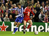 Photo: Paul Greenwood/Sportsbeat Images.<br />Liverpool v Porto. UEFA Champions League. 28/11/2007.<br />Porto's Marek Cech, left, attempts to disposess Fernando Torres