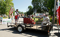 Charles and Cynthia Morrill  followed by the Girls Scouts during the Gilford Bicentennial Parade on Saturday morning.  (Karen Bobotas/for the Laconia Daily Sun)