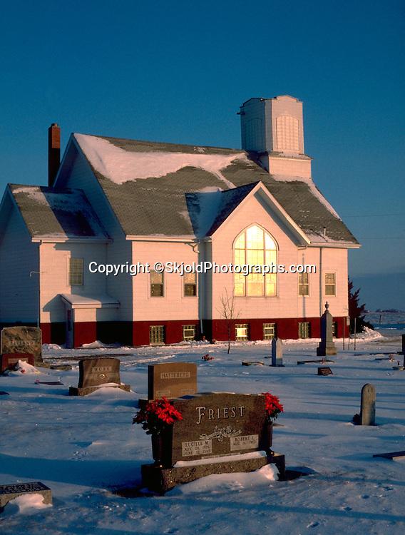 Church and cemetery with snow on ground. Garden City Iowa USA