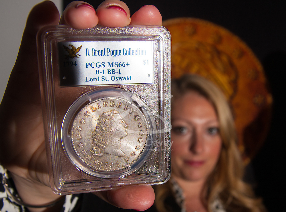 London, March13th 2015. Ahead of the first sale of the D. Brent Pogue rare United States Federal coin  collection sale to be held at Sotheby's  New York. The collection is composed of over 650 gold, silver, and copper coins, and is expected to be the most valuable collection of coins ever sold. PICTURED: The finest known example of a 1794 Silver Dollar, the first intended for circulation, which is expected to fetch up to 10 million United States dollars at auction.