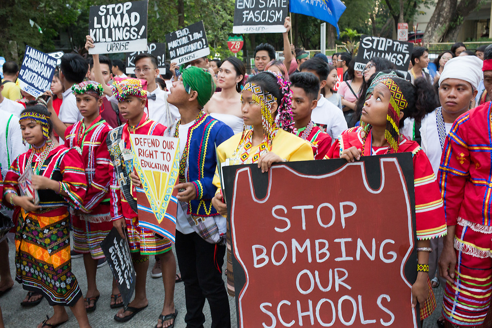 """Demonstration on Lumad rights, Manila, Phlippines. Interview with Kerlan Fenagal, Chair of PASAKA, the Confederation of Lumad Organisations in Southern Mindanao. <br /> <br /> """"Indigenous peoples are 14% of the total Filipino population of 110 million, so 15 million or so indigenous people in the country. The Lumad are a large group, particularly in Mindanao.<br /> <br /> We are victims of the continuing, and intensifying, militarisation, specially now, we are under Martial Law in Mindanao. All over the Philippines we are facing the Oplan Kapayapaan, the counter-insurgency programme of the Duterte regime. We are facing attacks on our efforts to establish our Lumad schools, that provide education to the Lumad. Duterte says that the schools are training grounds, recruiting stations, for insurgents. They call us terrorists and communists, that's how they tag us, but that is a pretext.<br /> <br /> The militarisation is to impose other policies, they have interests in our ancestral lands. They intensify attacks on our people and our culture because we defend our ancestral lands against mining, plunder, logging concessions, constructing mega-dams on our big rivers, like bulami river. They want to take our resources, they want to exploit our rainforests, the Pantaron Range. If you see the movie Avatar, that's how you can imagine the Pantaron Range, it is rain forest. They are already mining there, going from medium scale to large scale, the government sell the mines to foreign companies. The region is rich in gold, copper, nickel and coal. They want our resources, they use the military and paramilitaries to get them...<br /> <br /> (continued on next image caption)"""