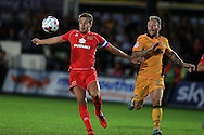 Scott Wooton of Milton Keynes Dons (l) holds off Sean Rigg of Newport county. .EFL cup, 1st round match, Newport county v Milton Keynes Dons at Rodney Parade in Newport, South Wales on Tuesday 9th August 2016.<br /> pic by Andrew Orchard, Andrew Orchard sports photography.