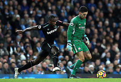 """West Ham United's Michail Antonio (left) and Manchester City goalkeeper Ederson (right) battle for the ball during the Premier League match at the Etihad Stadium, Manchester. PRESS ASSOCIATION Photo. Picture date: Sunday December 3, 2017. See PA story SOCCER Man City. Photo credit should read: Martin Rickett/PA Wire. RESTRICTIONS: EDITORIAL USE ONLY No use with unauthorised audio, video, data, fixture lists, club/league logos or """"live"""" services. Online in-match use limited to 75 images, no video emulation. No use in betting, games or single club/league/player publications."""
