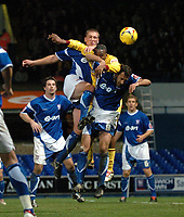 Photo: Ashley Pickering.<br />Ipswich Town v Burnley. Coca Cola Championship. 02/12/2006.<br />Burnley's Gifton Noel-Williams (yellow) is sandwiched between Jason De Vos (L) and Sylvain Legwinski (R)