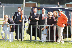 Queen Beatrix visiting Breda Hippique with Princesses Amalia and Ariana watching competion with World Champion four in hand, IJsbrandt Chardon (NED)<br /> Also in the picture (L) Bert Wassenaar, equerry to the Queen and Martin Van den Heuvel, president of the Royal Dutch Equestrian Federation<br /> Breda Hippique 2010<br /> © Dirk Caremans
