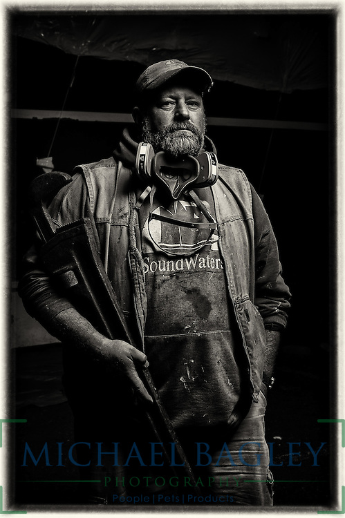 A portrait of Josh, the Mate aboard the Schooner SoundWaters, during winter maintenance period.
