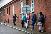 Asylum seekers stand behind fencing wearing mask inside Napier Barracks on the 12th of January 2021, Folkestone Kent. Over 400 asylum seekers are being kept at Napier Barracks in unsuitable, cold accommodation, they are experiencing mental health issues as well as being vulnerable to health conditions including COVID-19. 3 people living inside the barracks have attempted suicide in 2021 already. <br /> (photo by Andrew Aitchison / In pictures via Getty Images)