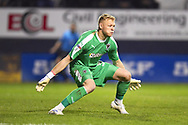 AFC Wimbledon goalkeeper Aaron Ramsdale gets low to save a shot in the first half during the EFL Sky Bet League 1 match between Luton Town and AFC Wimbledon at Kenilworth Road, Luton, England on 23 April 2019.