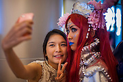 "11 MAY 2014 - BANGKOK, THAILAND: A girl takes a selfie of herself and a ""cosplay"" (Costume Play) participant at Thailand Comic Con at Siam Paragon Mall in Bangkok.    PHOTO BY JACK KURTZ"