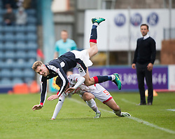 Ross County's Greg Morrison tackles Dundee's Kevin Holt. Dundee 1 v 1 Ross County, SPFL Ladbrokes Premiership played 13/5/2017 at Dens Park.