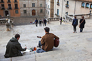 Musician and artist on the steps to the the Cathedral of Saint Mary of Girona, Catalonia, Spain. (c) 20014 Dave Walsh