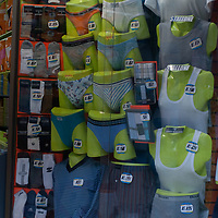 Mannequins display underwear, clothing and socks in a store window in Lima, Peru.