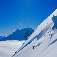 A skier descends steep powder slopes below the Detroit Plateau, far inland on the Antarctic Peninsula.