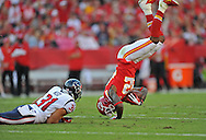 KANSAS CITY, MO - OCTOBER 20:  Wide receiver Dwayne Bowe #82 of the Kansas City Chiefs gets flipped after catching a pass for a first down by free safety Shiloh Keo #31 of the Houston Texans during the first half on October 20, 2013 at Arrowhead Stadium in Kansas City, Missouri.  (Photo by Peter Aiken/Getty Images) *** Local Caption *** Dwayne Bowe;Shiloh Keo