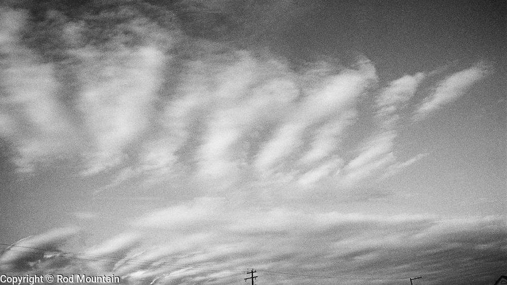 Cloudscape forms above the telephone lines. Vancouver, British Columbia