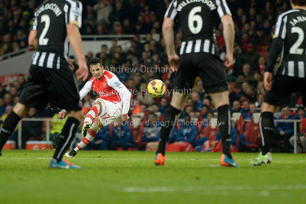 Alexis Sanchez of Arsenal taking a free kick. Barclays Premier league match, Arsenal v Newcastle Utd at the Emirates Stadium in London on Saturday 13th December 2014.<br /> pic by John Patrick Fletcher, Andrew Orchard sports photography.